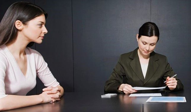 Woman asking important divorce questions to a divorce lawyer